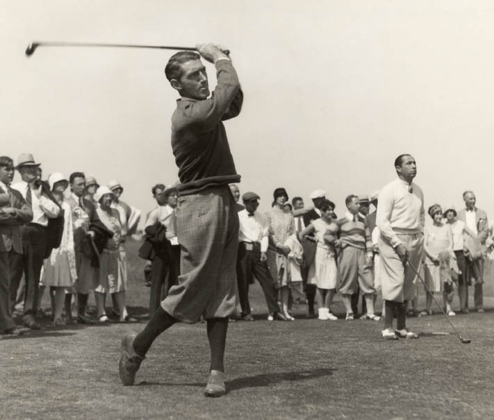 Tommy hitting as mentor Walter Hagen looks on