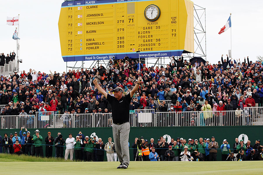 Clarke celebrates his Open victory on the 18th green