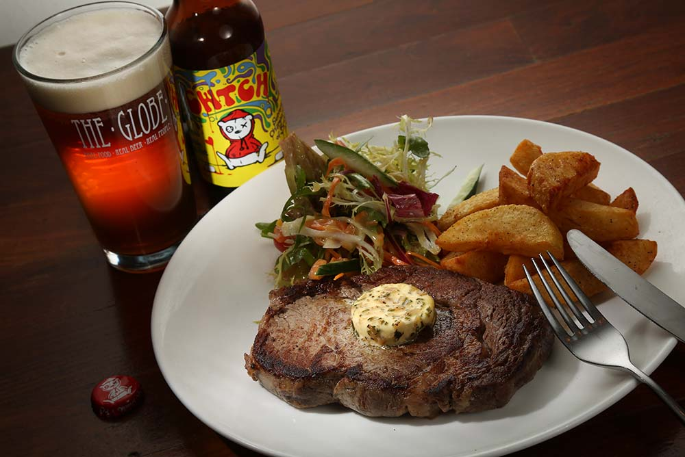 Voted one of the top 21 best beer bars in the world, The Globe is featuring this amazing 10oz Ashdale Farm Rib Eye with Tiny Rebel Cwtch