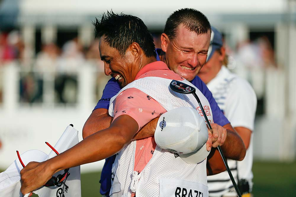 An emotional Brazel celebrates with his caddie