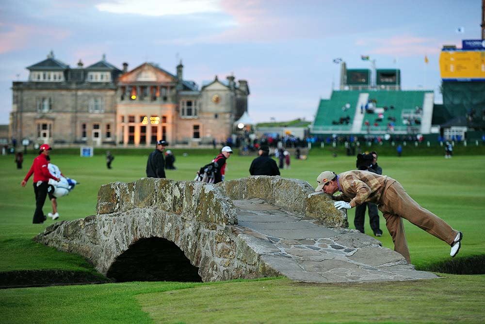 Tom Watson kisses the Swilcan Bridge during the 2010 British Open