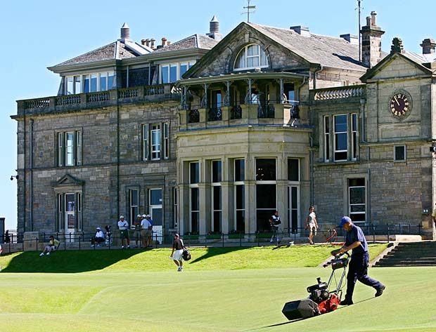 A groundsman mows grass in front of the club house on the Old Course during a practice round ahead of The Open Championship in St Andrews