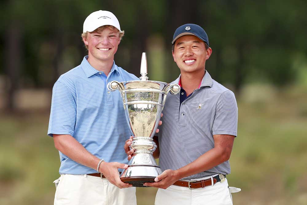 Frankie Capan (left) and Ben Wong with the trophy at the end of match play at the 2017 U.S. Amateur Four-Ball