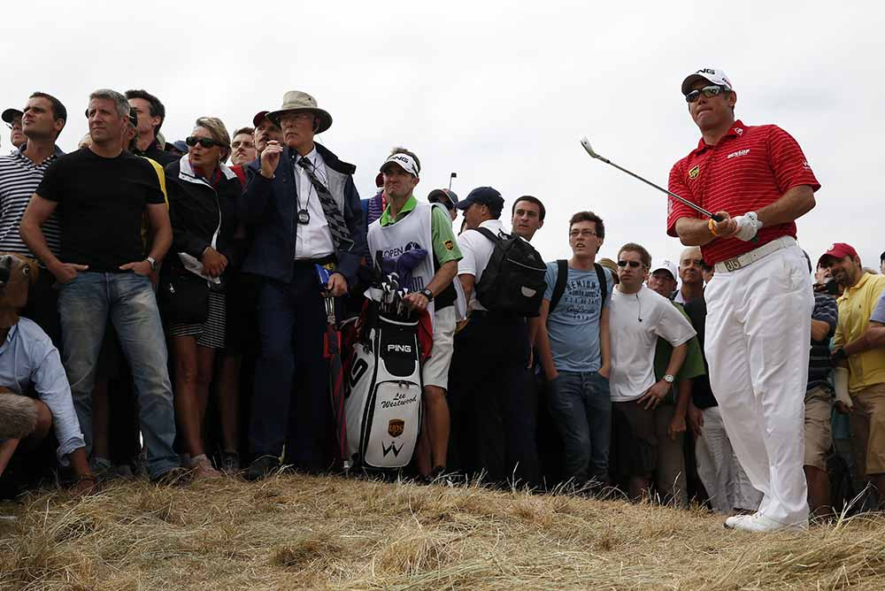 Lee Westwood watches his shot played out of the rough during the 2013 Open