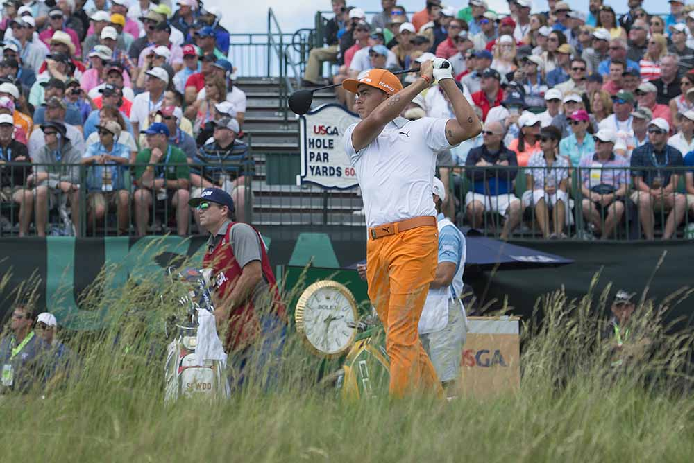 Rickie Fowler took the first-round lead with a 65
