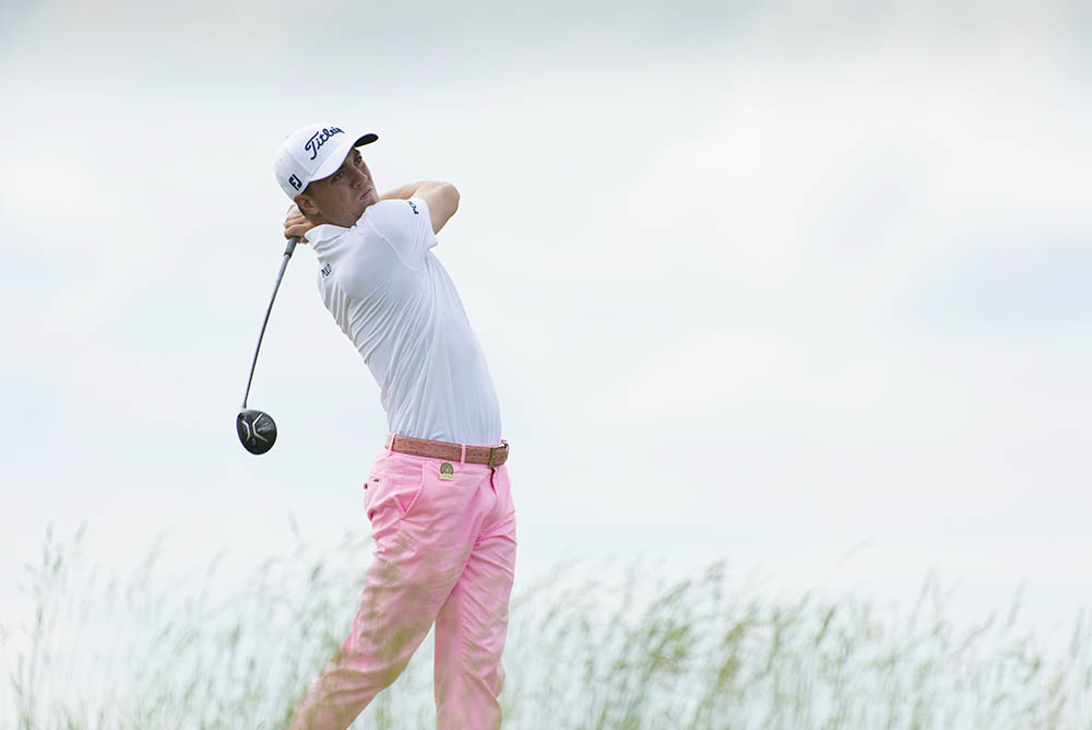 Justin Thomas hits his tee shot on the 18th hole during the third round