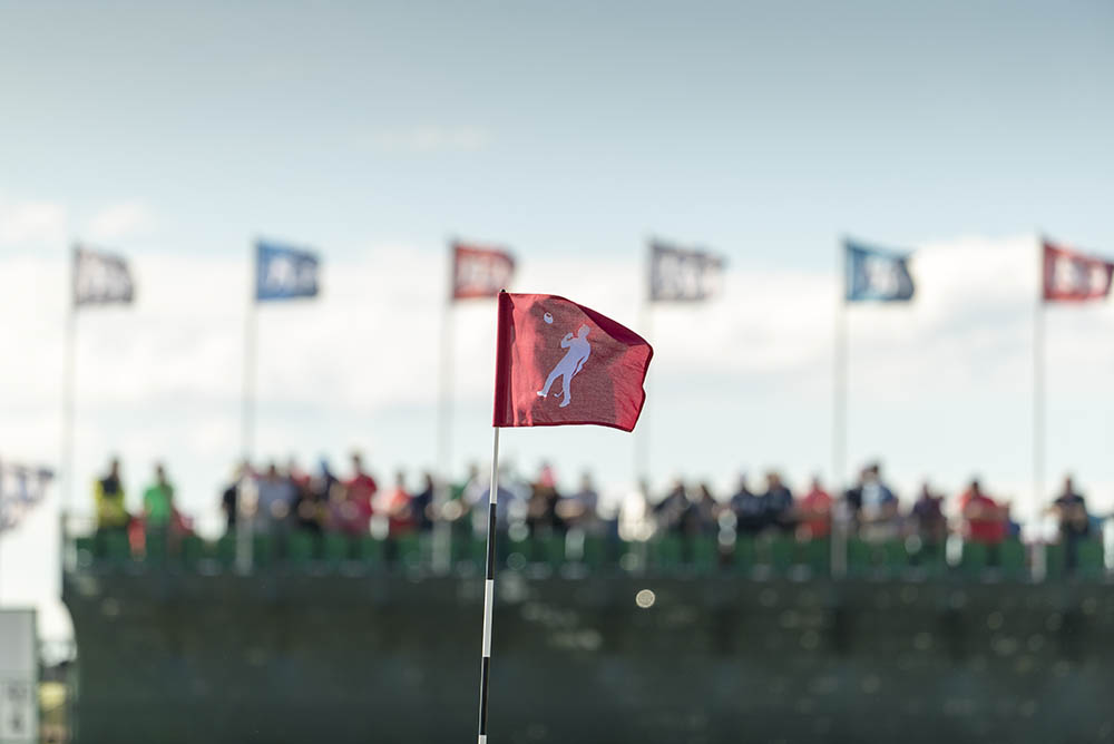 A view of the flag on the 18th featuring Arnold Palmer at Erin Hills