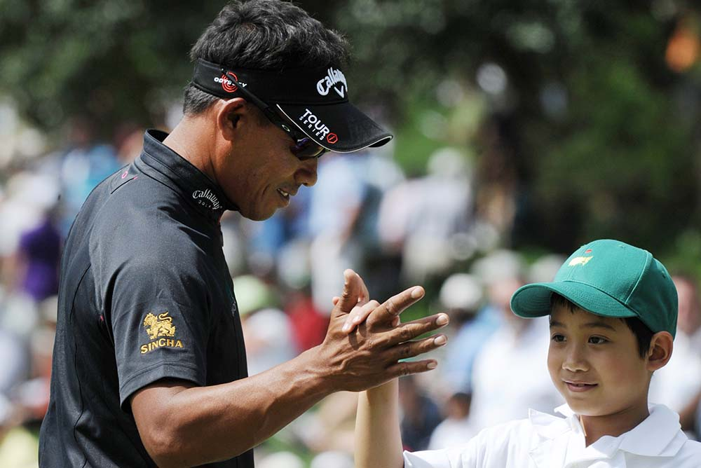 Thongchai Jaidee and his son Titituch at the par-3 competition of 2010 Masters