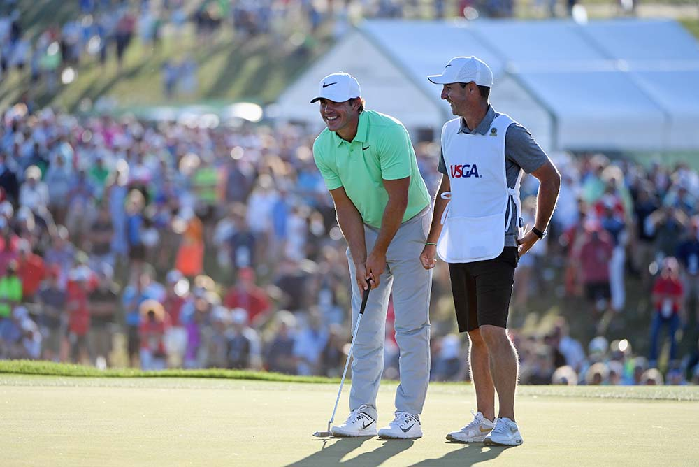 Brooks Koepka and caddie Richard Elliott