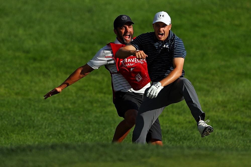 Jordan Spieth celebrates with caddie Michael Greller