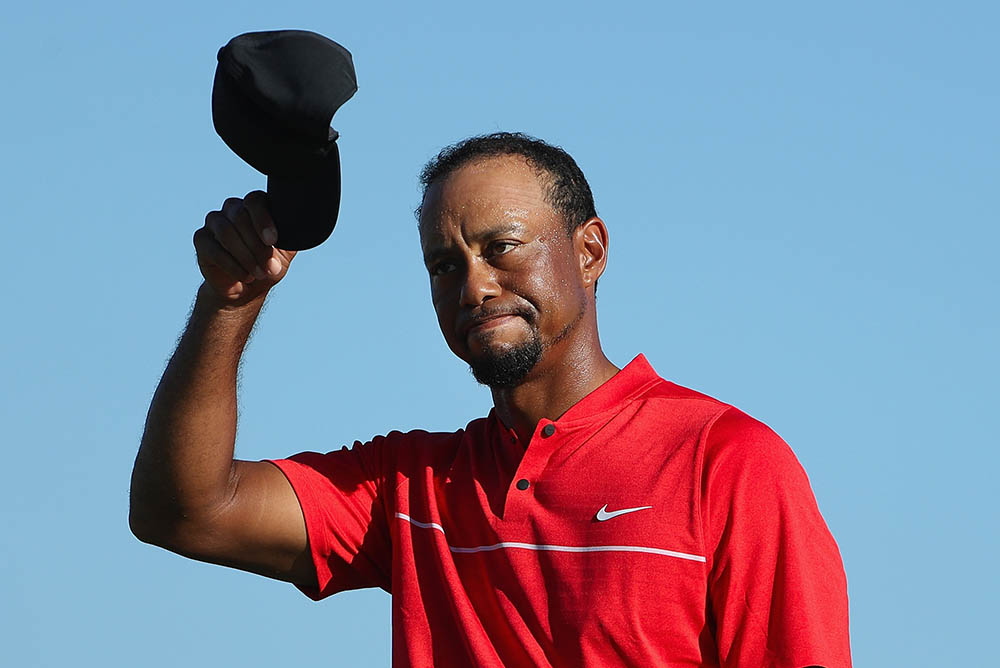 Tiger Woods tips his cap during the final round of the Hero World Challenge
