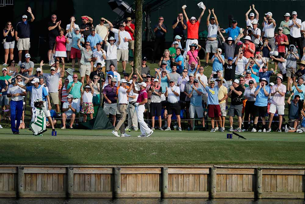 Sergio Garcia celebrates his hole in one on the 17th with Adam Scott during the first round of THE PLAYERS Championship at the Stadium Course at TPC Sawgrass
