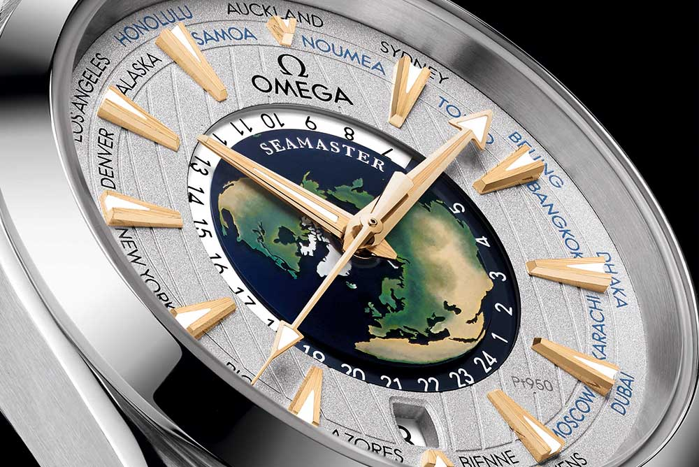A sapphire crystal central dial with a hand-crafted enamel world map