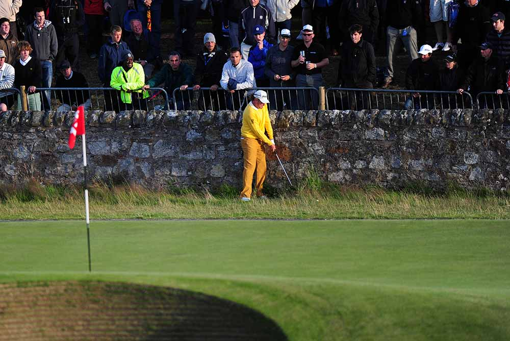 Miguel Angel Jiménez plays his ball back off the wall onto the road hole Green