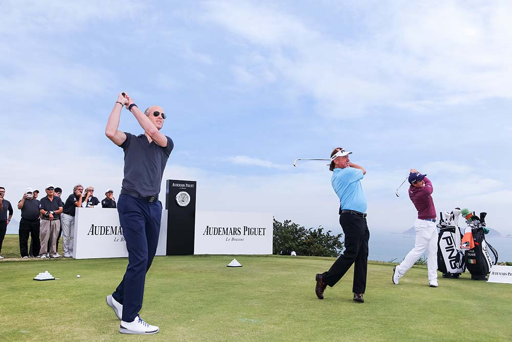 The ambassadors kick-start the event by hitting the opening drives with von Gunten (left) together