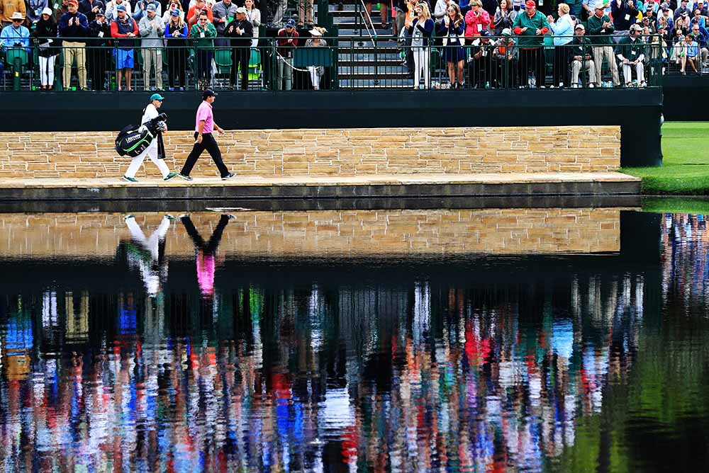 Patrick Reed and caddie Kessler Karain cross the Sarazen Bridge