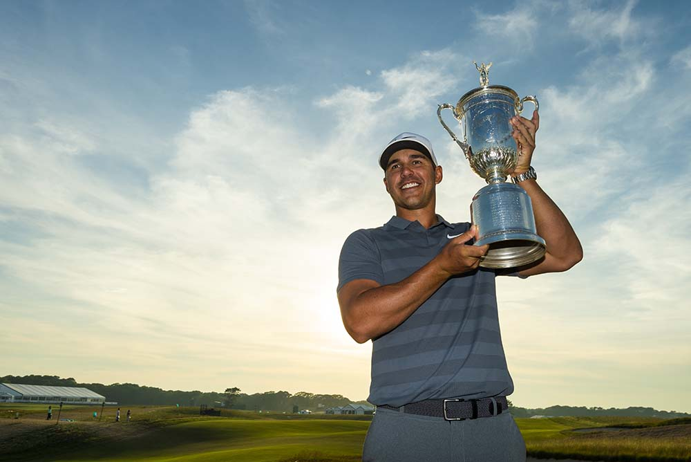 Brooks Koepka poses with the trophy after winning the 2018 U.S. Open
