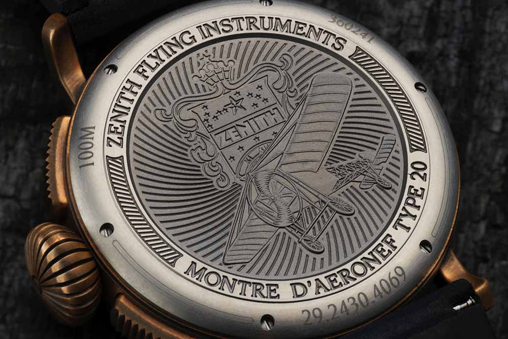 Solid titanium case back engraved with the Zenith flying instruments logo