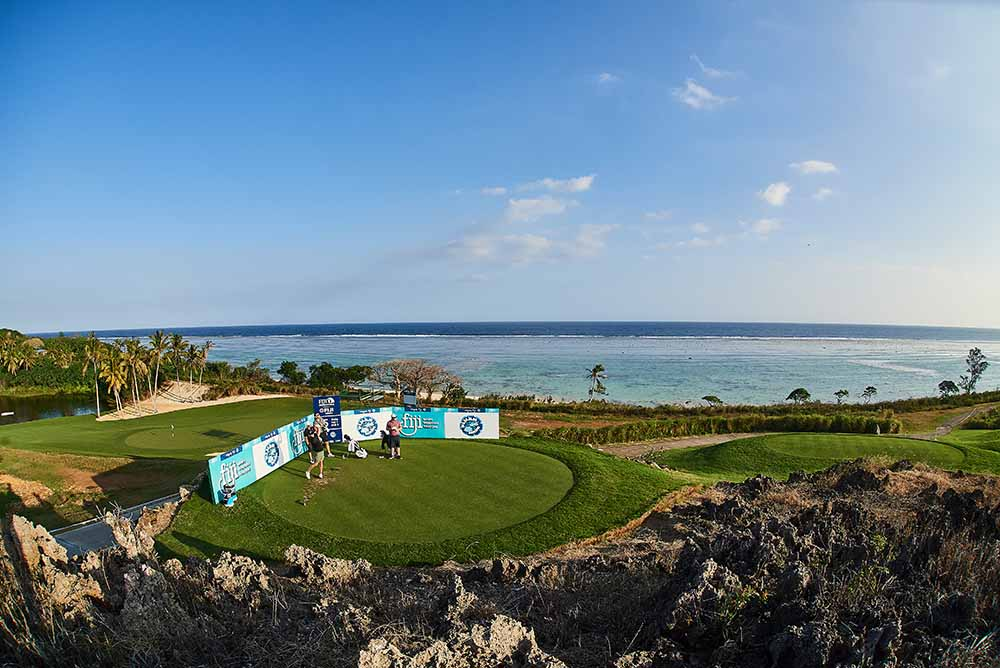 Pros teeing off against the backdrop of one of the most scenic venues in the world