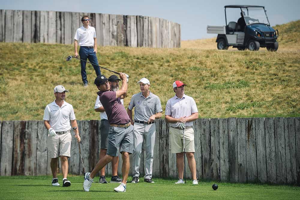 Brian Harman, Kevin Kisner and captain Jim Furyk practice