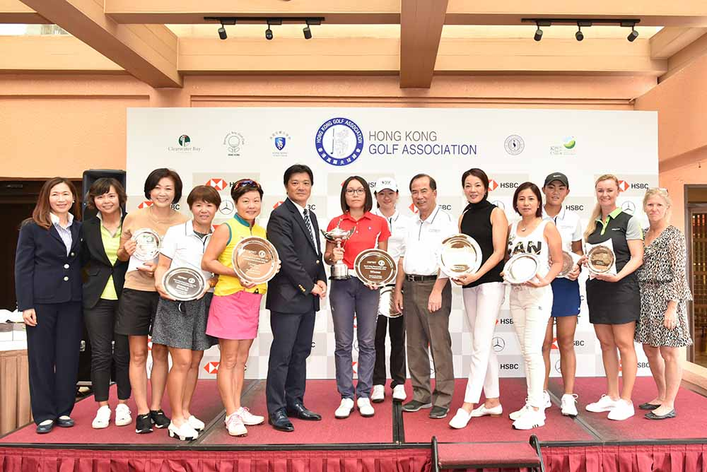 Yoshihiro Nishi, President of the HKGA, presents trophies to all Esprit HK Ladies Open & Mid Amateur Championships winners