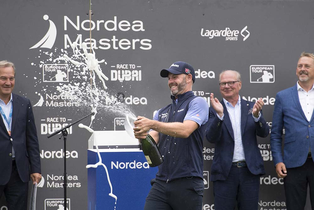 Englishman Paul Waring celebrates winning the Nordea Masters